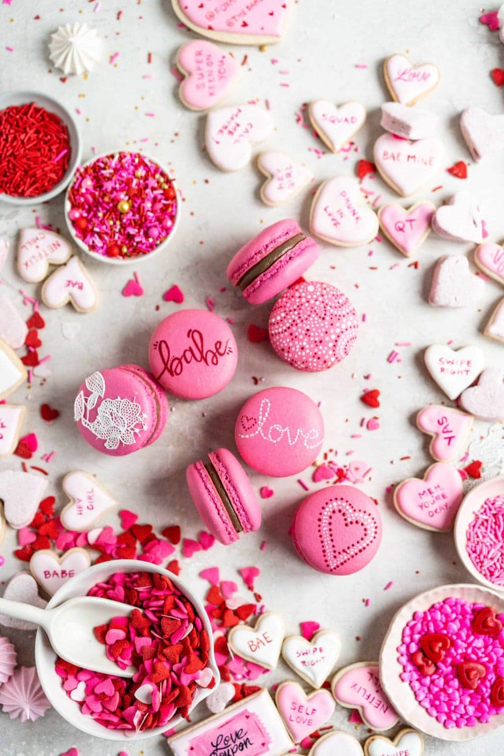 macarons on surface painted with valentine's images