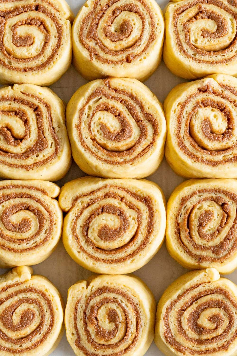 close up shot of brown butter cinnamon rolls ready for the oven