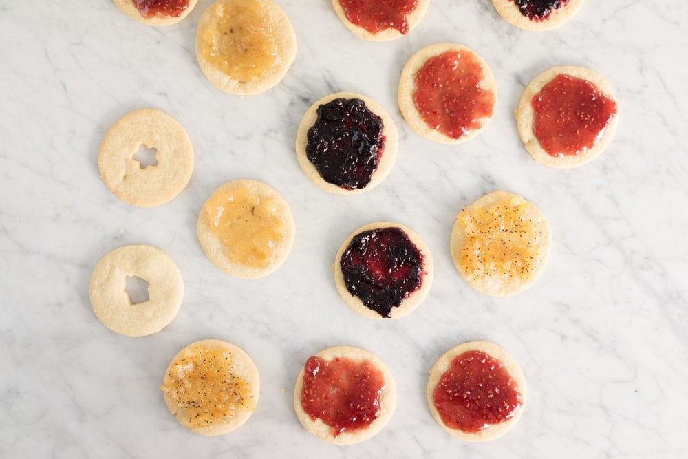 Quick roll-out cookies sandwiched with homemade raspberry jam