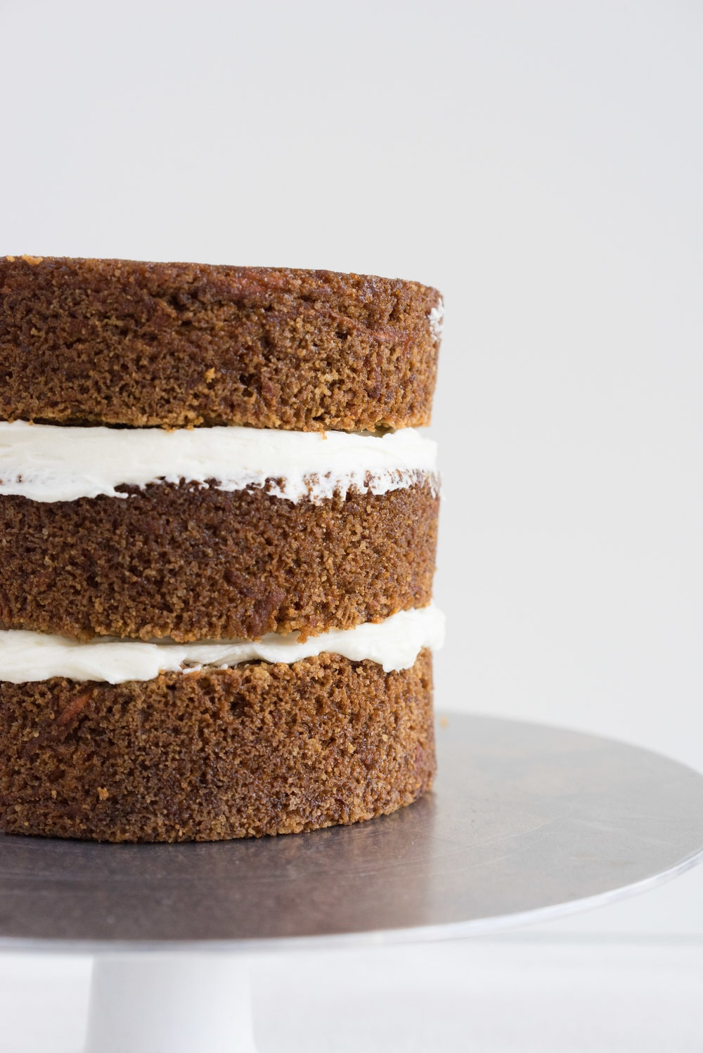 Carrot Cake with cream cheese icing that is super easy to pipe. The cake is moist and flavourful, and the icing has the perfect amount of sweetness and cream cheese punch.