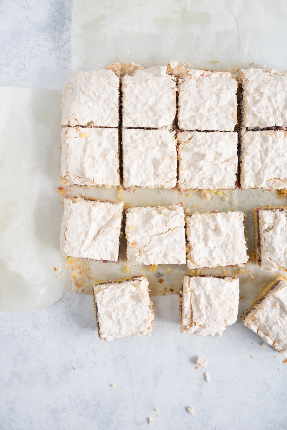 Louise cake - shortbread base spread with a raspberry jam layer then topped with a coconut meringue. The perfect afternoon tea accompaniment