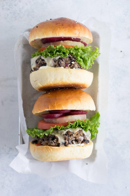 Black bean burgers with homemade brioche burger buns - the perfect vegetarian meal that even the staunchest of hamburger eater will love! #vegetarian #blackbeanburger