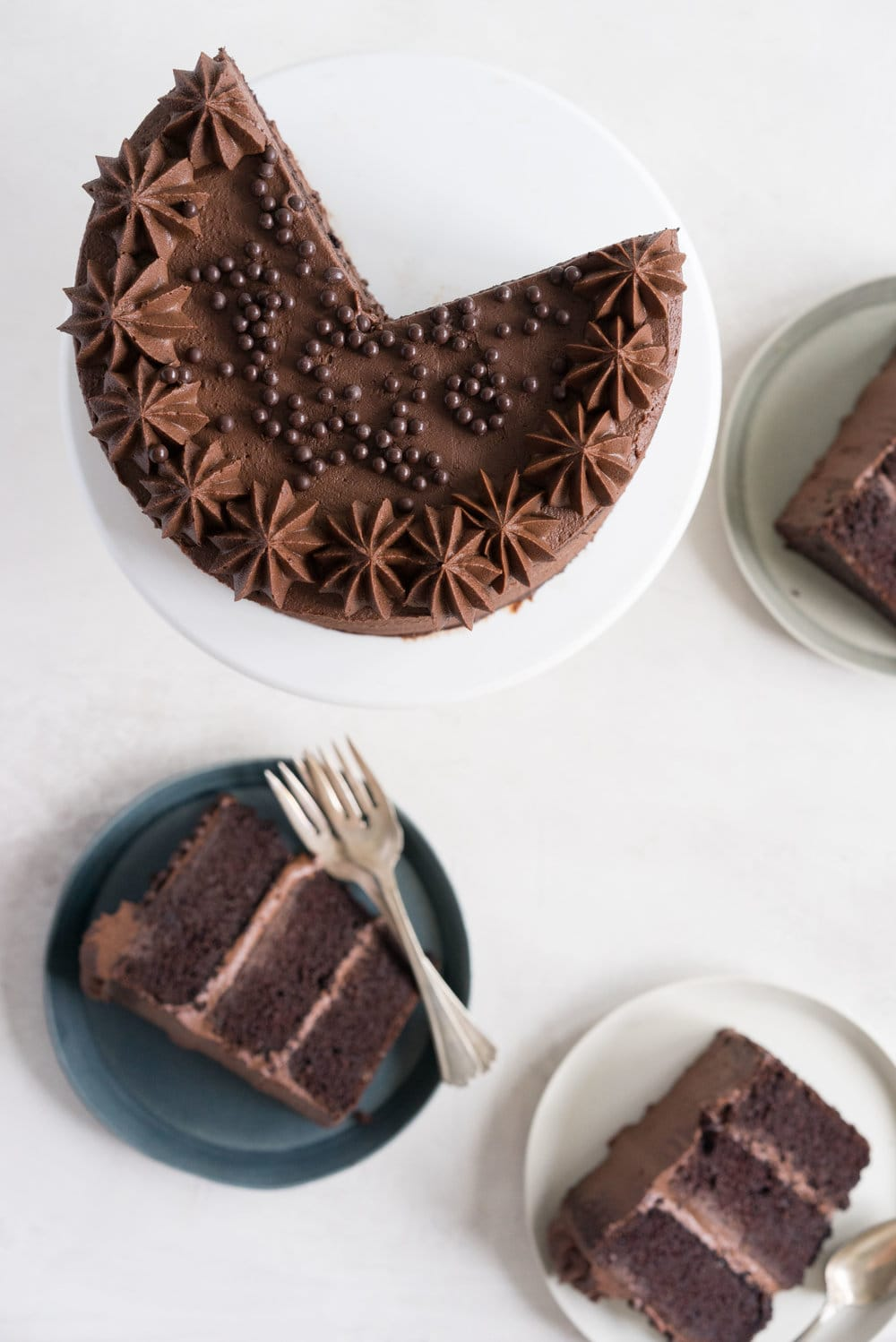 One Bowl Devil's food Layer Cake with Milk Chocolate Frosting - from the new Bravetart book! Dark chocolate cake is prepared in one bowl, baked into perfect layers, then frosted with a smooth, creamy milk chocolate frosting. The ultimate chocolate lover's cake. #devilsfood #layercake #chocolatecake #bravetart #milkchocolate