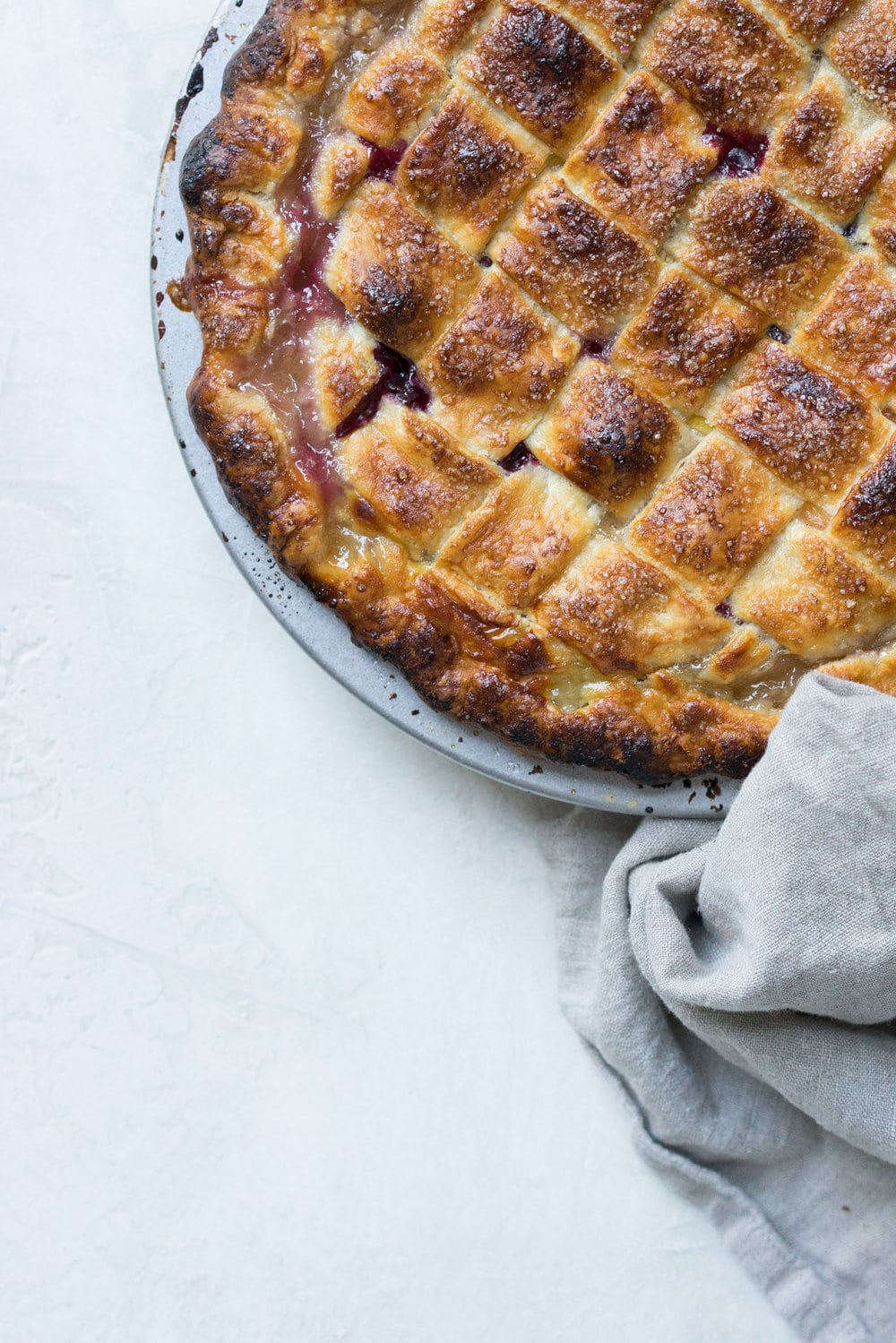 Peach and blueberry pie. The epitome of summer - flavourful fruit, held together in a flaky tender crust, elevated by a touch of sugar. The perfect summer dessert - when you have amazing fruit, you can keep things simple. #peachpie #blueberrypie #homemadepie #fruitpie #piedough #pierecipe #latticepie #peachandblueberrypie