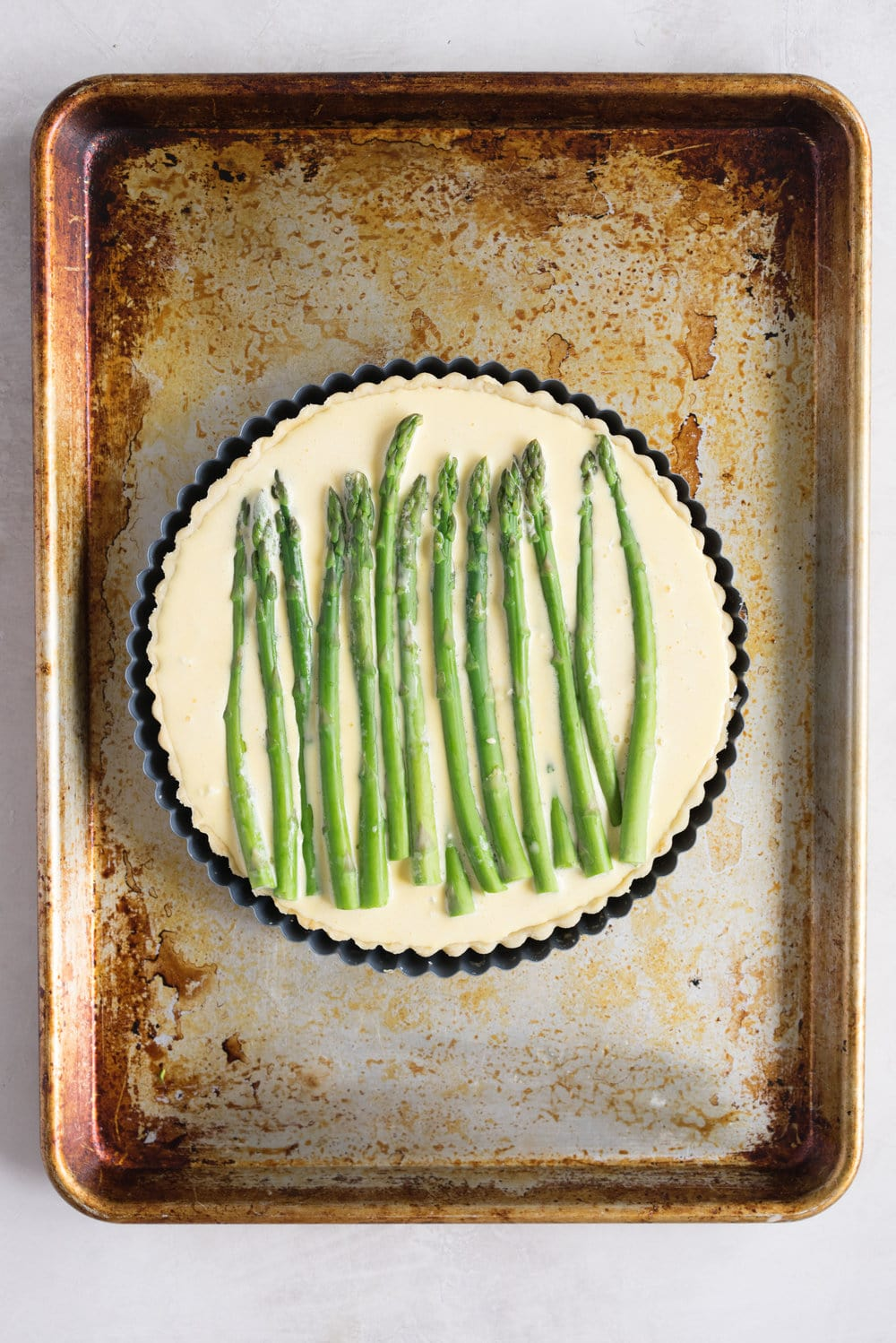 Asparagus, Goat Cheese, and Caramelised Onion Quiche - Flaky pie dough, caramelised onion, creamy goat cheese, baked into the perfect quiche. A great way to use up bits and bobs in your fridge. Would also be great with broccoli! #quiche #caramelisedonion #savouryquiche #savoryquiche #asparagus #goatcheese #chevre