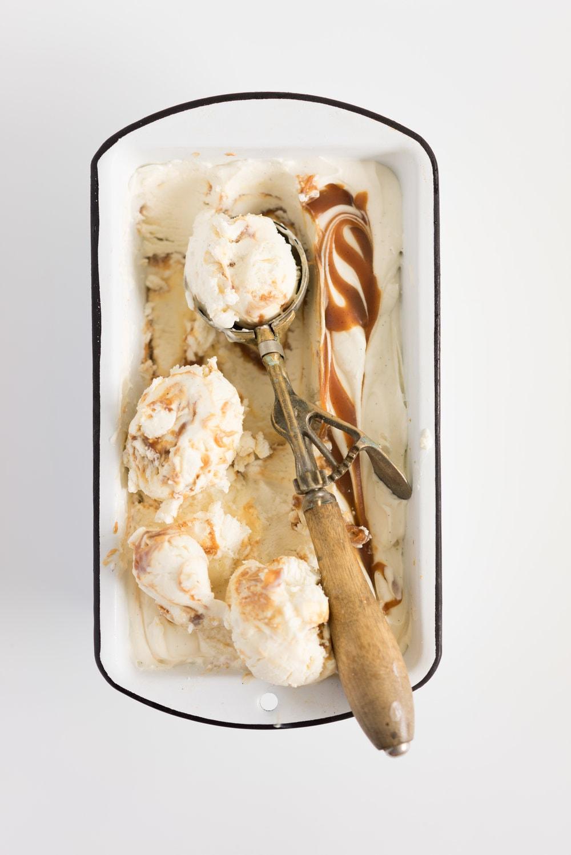 Salted Caramel No churn Ice Cream - creamy vanilla no churn ice cream is swirled with a spiced salted caramel ripple. A fancy wee twist on everyone's favourite no-churn recipe #nochurn #icecream #saltedcaramel #caramel #vanilla #nochurn