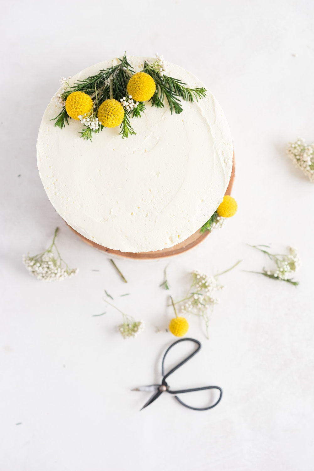 Earl Grey Cake with Raspberry Filling and Vanilla German Buttercream - A delicate earl grey infused cake, filled with a tart raspberry filling, and finished with a creamy vanilla bean german buttercream