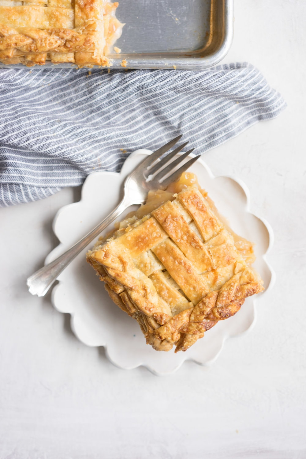 Apple Slab pie - perfect for a crowd, this apple slab pie combines juicy apples and tender flaky pie crust into the perfect make-ahead dessert, perfect for any season