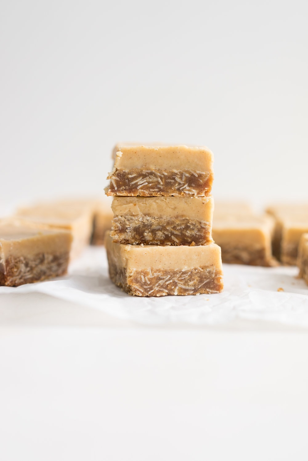 Ginger crunch - a classic 'slice' or bar recipe from New Zealand. A crumbly oaty base is topped with a sweet, spicy ginger icing. The perfect treat.
