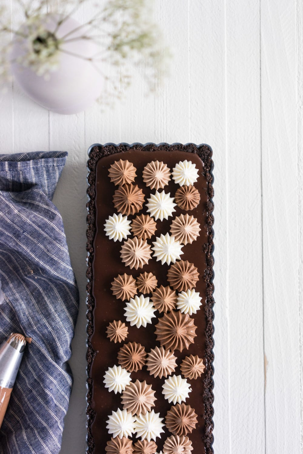 Milk Chocolate Earl Grey Tart with Ombre Dark Chocolate Swiss Meringue Buttercream. A press in cookie crust is topped with a silky earl grey infused ganache filling, then finished with an ombre swiss meringue buttercream.