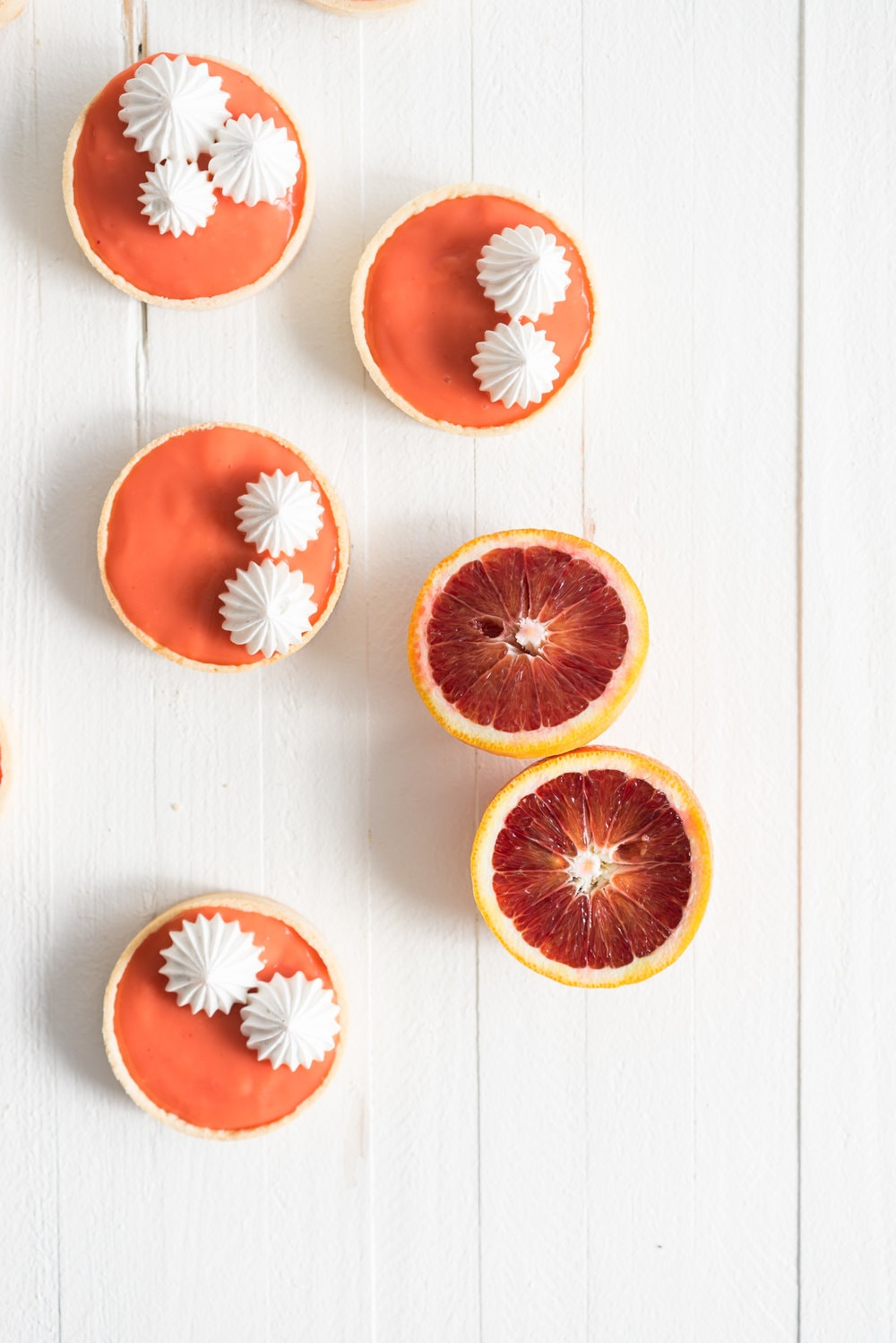 Blood orange meringue tart - sweet pastry filled with a blood orange curd and topped with a swiss meringue