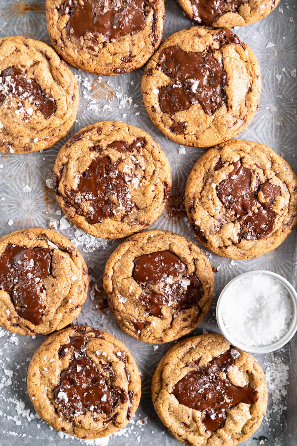 The Perfect Chocolate Chip cookie - lightly salted dough surrounds puddles of dark chocolate, before being finished up with a heavy dose of flaky sea salt. These cookies utilise three different types of sugar - white, dark brown or muscovado, and turbinado sugar for a little crunch. They are easy to make and I show you how to get the best chocolate puddles in the recipe!
