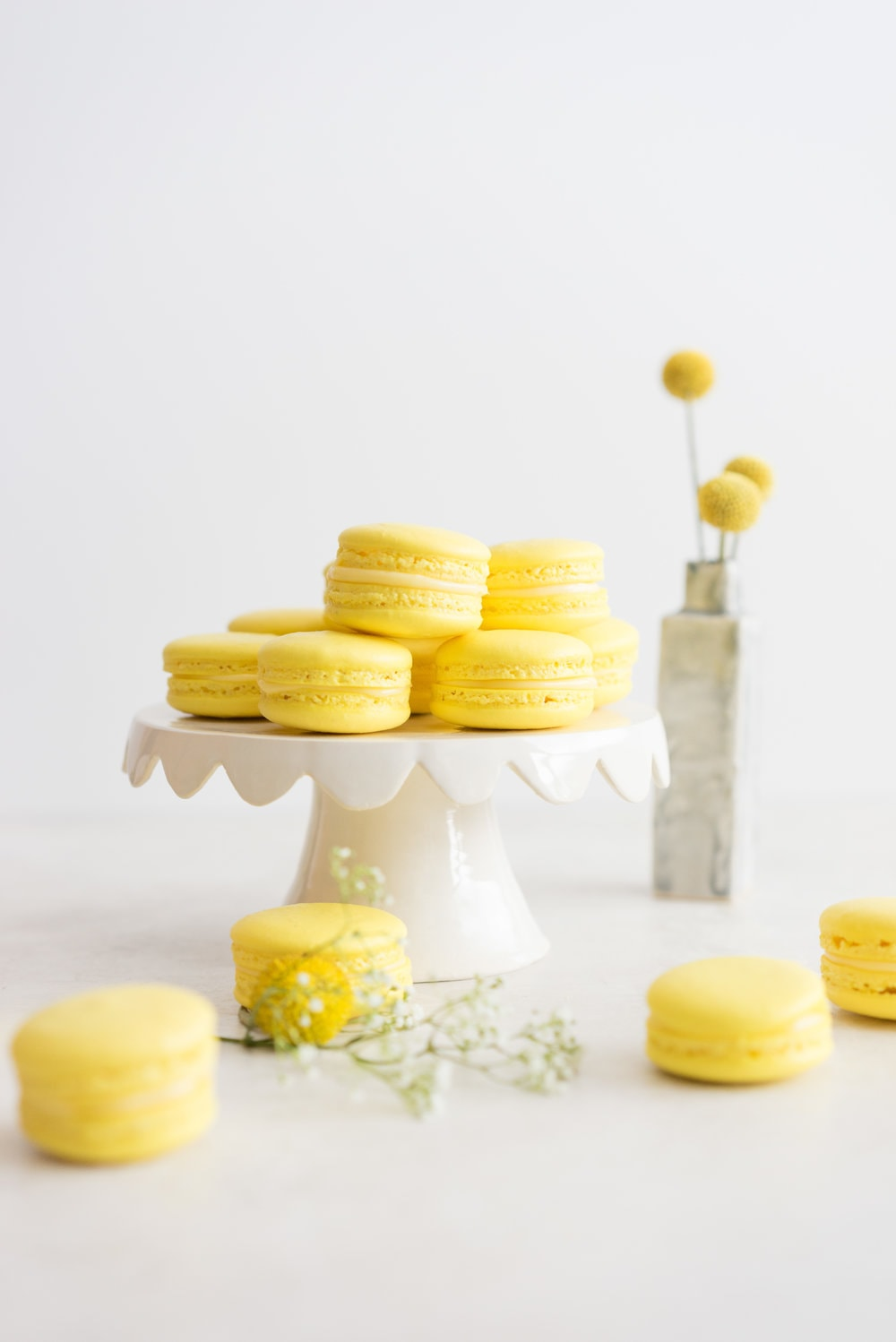 Lemon and Basil Macarons - French Macaron shells are filled with a lemon and basil cream, and a tart lemon gel. Delicate an intense flavours meld together to create the perfect bite.
