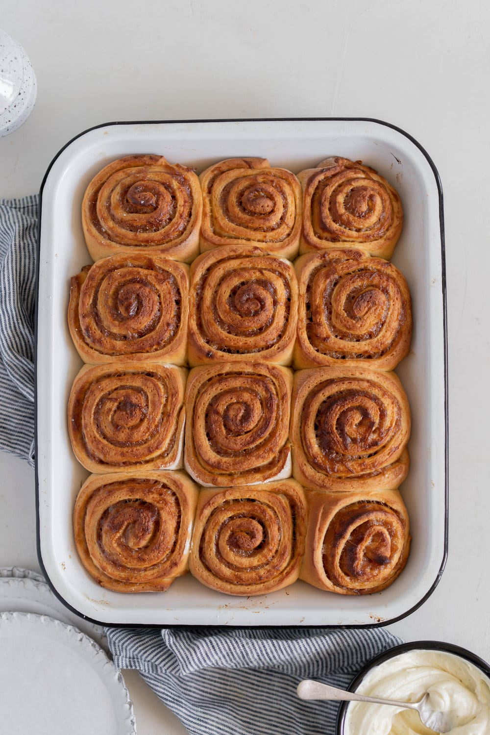 Rhubarb Sticky Buns - Brioche Spiked with vanilla, filled with rhubarb quick jam, and finished with a vanilla bean mascarpone frosting. #stickybuns #rhubarb #vanillabean #cloudykitchen