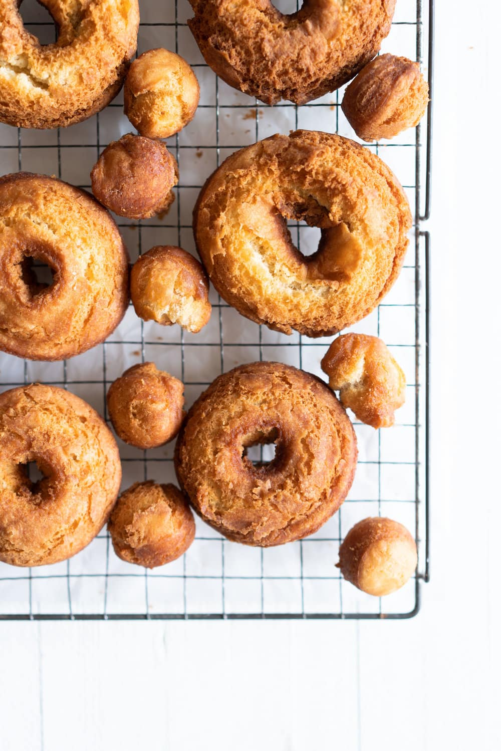 Vanilla Bean Old Fashioned Doughnuts - made as a cake doughnut rather than it's friend the yeast raised doughnut, old fashioned doughnuts are cakey and dense, fried to golden perfection, and then finished with a vanilla bean glaze. #oldfashioned #doughnuts #cakedoughnuts #cakedonut #vanillabean #staub