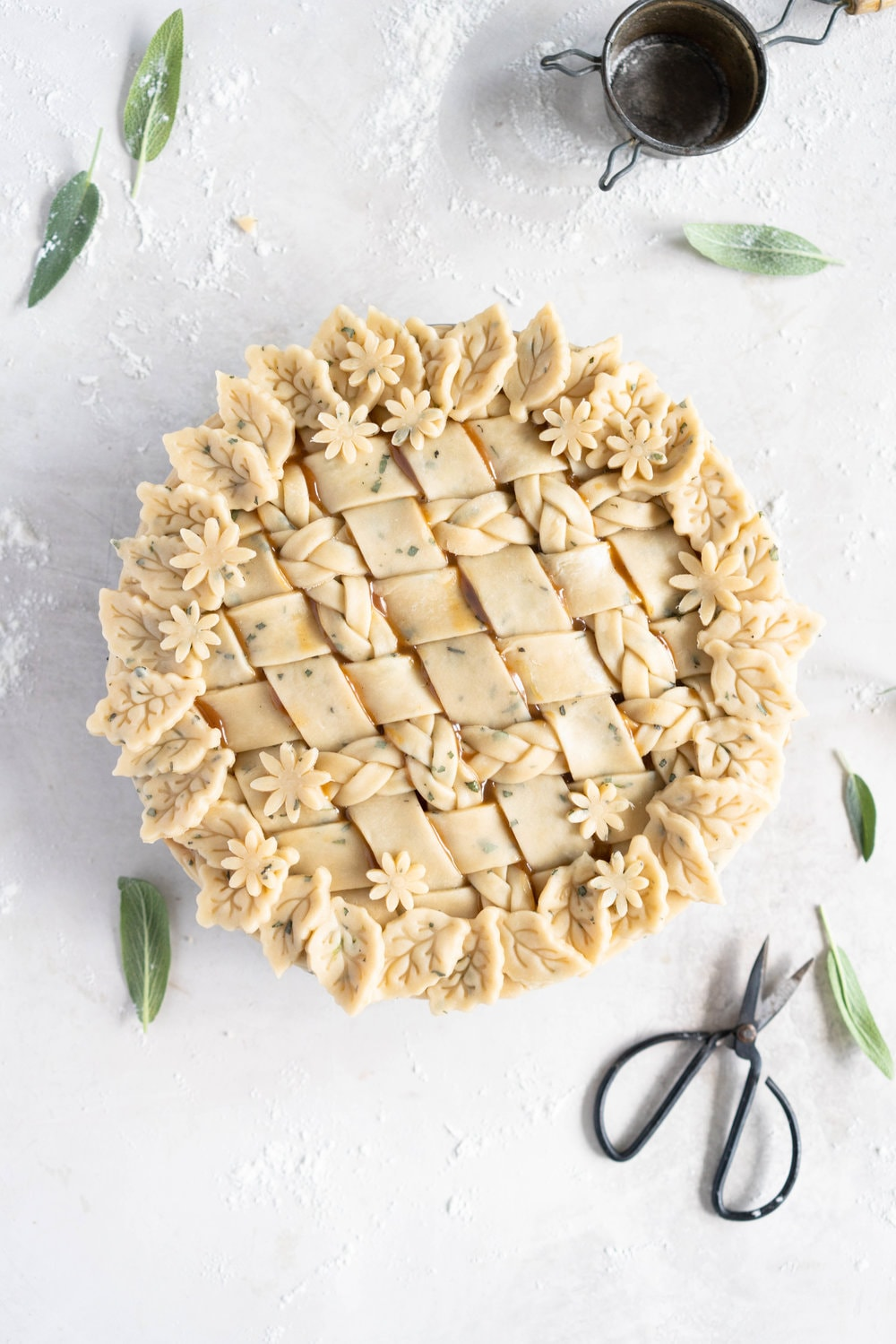Sage Salted Caramel Apple Pie with Fresh Sage Crust - Flaky pie dough flecked with fresh sage holds an apple filling, topped with a sage salted caramel. A perfect twist on the classic salted caramel apple pie.