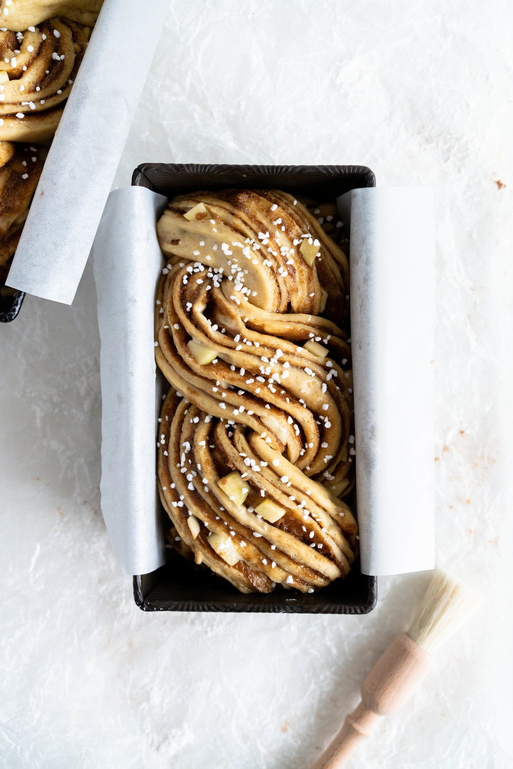 Apple and Cardamom brioche babka - lightly spiced babka dough is filled with a spiced brown sugar mixture and fresh apple, then rolled into a tight babka swirl. Inspired by the swedish cinnamon roll, this is a perfect fall baking project. #babka #cardamom #brioche