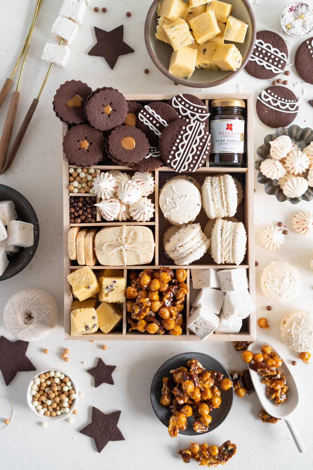 The Ultimate Vanilla Bean Christmas Box. All of the christmas treats for your recipe planning for this upcoming holiday season! Chocolate Shortbread cookies with Vanilla bean Dulce de Leche filling, vanilla bean meringues, vanilla bean macarons, Vanilla bean shortbread, vanilla bean passionfruit fudge, vanilla bean salted caramel nut mix, and vanilla bean marshmallows. The perfect treat box for christmas!