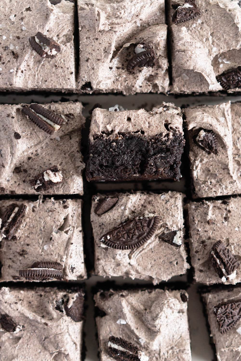 Dark, fudgy black cocoa brownie is topped with an oreo german buttercream and finished with chunks of oreo and flaky sea salt. This is a delicious twist on the traditional brownie.