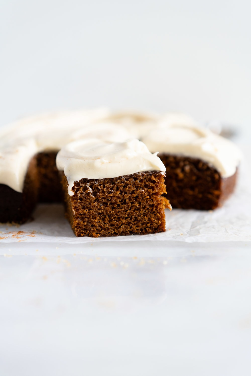 Gingerbread Sheet Cake with Maple Cream Cheese Frosting - a warming spiced cake, topped with a silky, maple, ream cheese frosting. A super simple yet delicious cake, perfect for feeding a crowd or for a quick holiday pick me up.