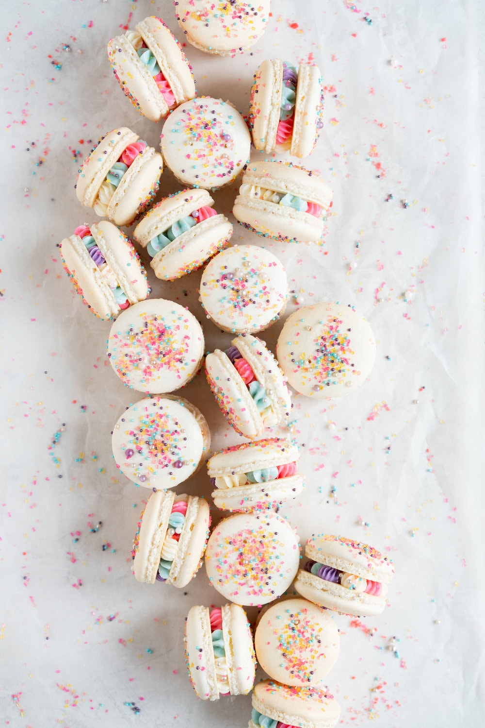 New Year's Macarons with Vanilla Bean Swiss Meringue Buttercream and Pop Rocks. Light, sparkly, and perfect for ringing in the new year.
