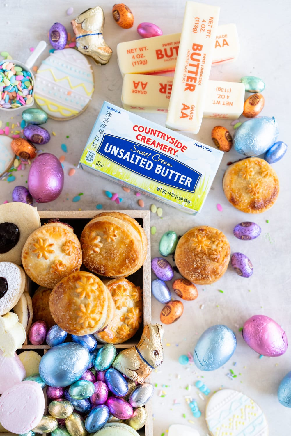 The Ultimate Easter treat box - iced cookies, cardamom linzers, hand pies, macarons, crispy rice treats and Easter mallows make the most amazing treat box, and are complimented perfectly by super cute foil wrapped chocolate eggs. This box would make the most perfect Easter gift, or the components are perfect alone for Easter treats. #easterbox #cookiebox #easterbaking