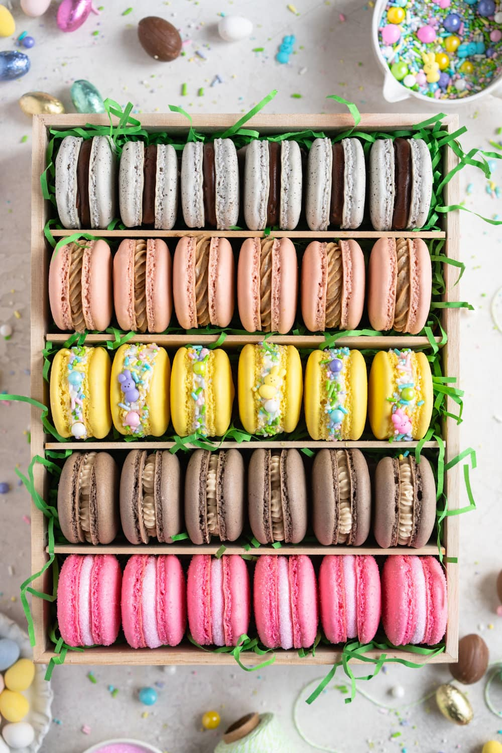 The ultimate Easter Macaron Box - creme egg macarons, hot cross bun macarons, coconut macarons, chocolate peanut butter macarons and peeps marshmallow macarons make up the most amazing Easter inspired box. This would make an incredible easter gift, and can be customised however you like!