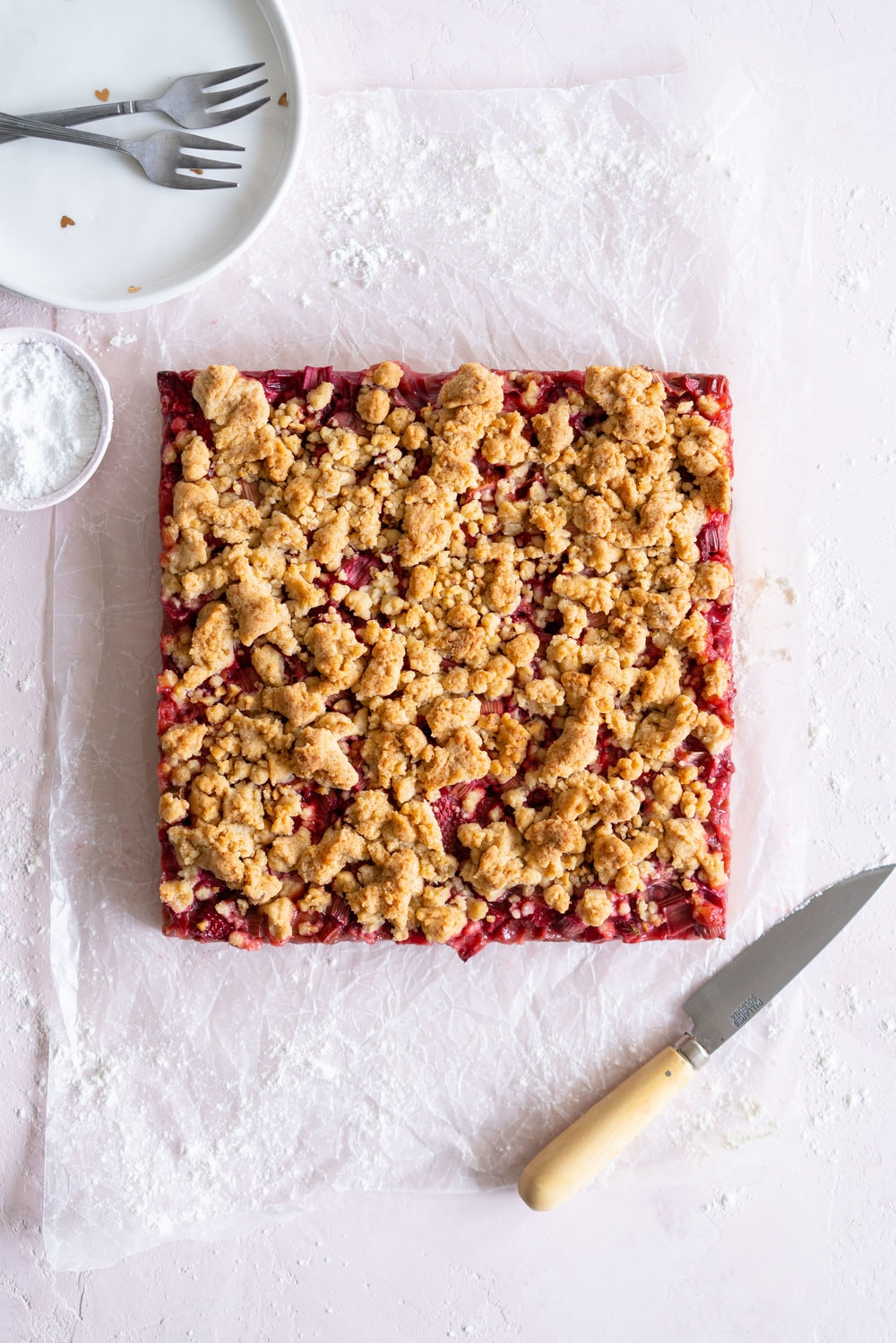 Brown Butter Hazelnut Strawberry Rhubarb Crumb Bars - a brown butter hazelnut shortbread is used as both the base and the crumble topping for these strawberry rhubarb crumb bars. These are the perfect early summer easy dessert! #crumbbars #strawberryrhubarb #brownbutter
