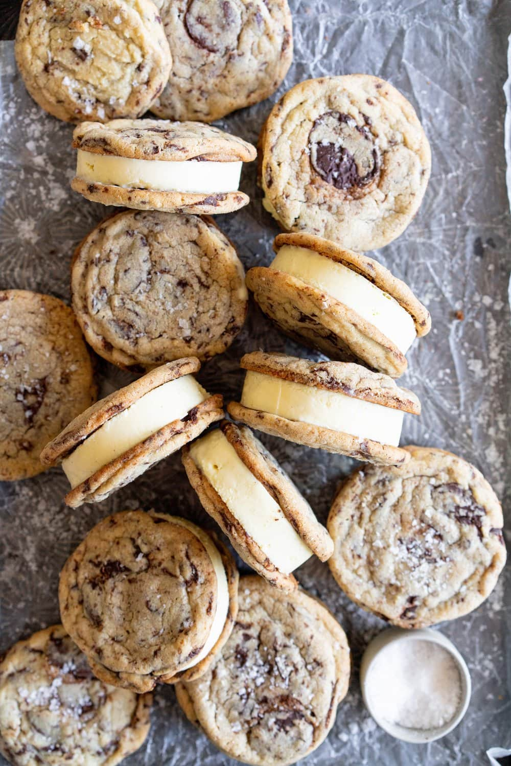 Chocolate Chip Cookie Ice Cream Sandwiches with Olive Oil Ice Cream. Thin and crispy chocolate chip cookies sandwich a creamy, smooth disc of olive oil ice cream. The perfect summer treat. #oliveoilicecream #icecreamsandwich #chocolatechipcookie