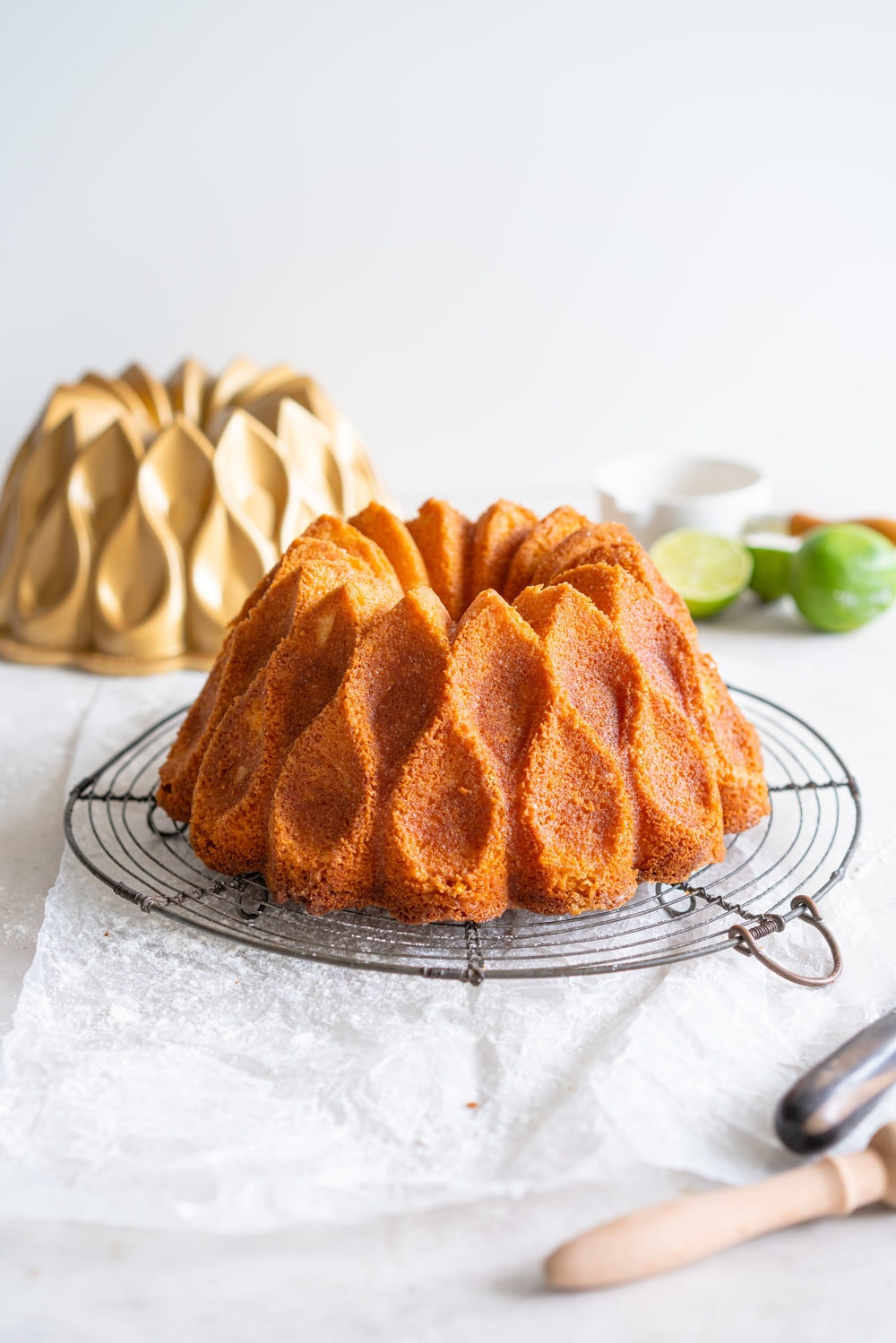Maida Heatter's East 62nd Street Lemon Cake (Lemon and Lime Bundt Cake). This recipe comes from the legendary Maida Heatter's latest book, Happiness is baking. It is a tender crumbed lemon cake, brushed with a crunchy sugary glaze. Incredibly easy and so, so delicious. #maidaheatter #lemoncake #bundtcake