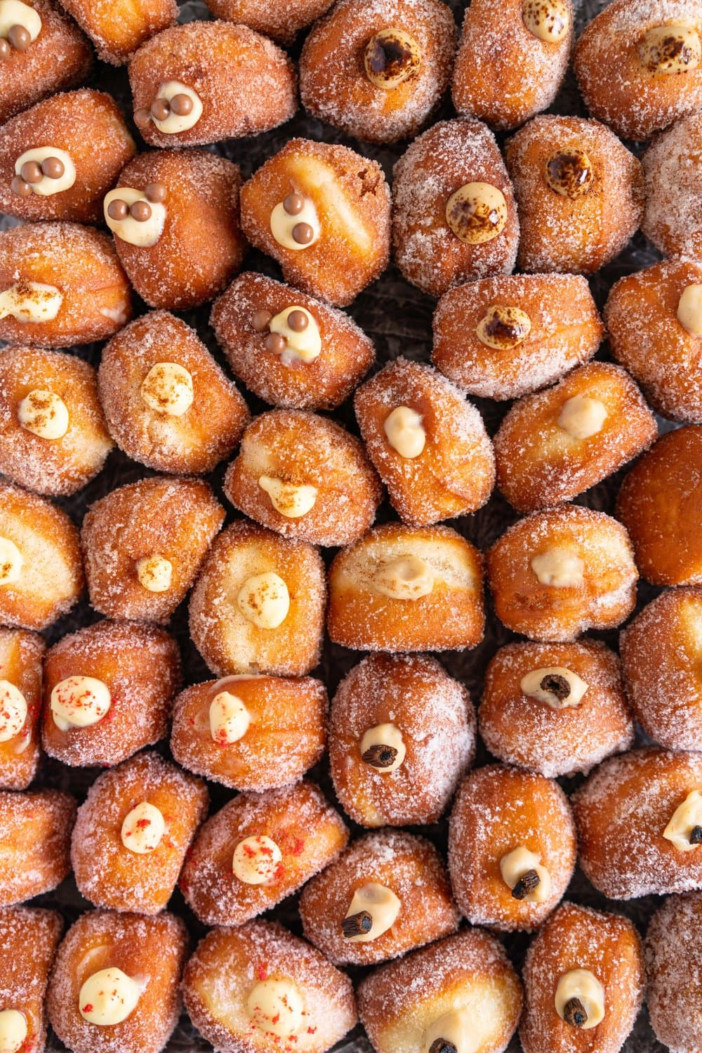 Perfectly fluffy mini brioche doughnuts are fried to perfection, rolled in sugar, and filled with flavoured pastry cream. A whole tray of mini doughnuts would be perfect for a special occasion or gathering, as they are a hit with all ages! #doughnut #briochedoughnut