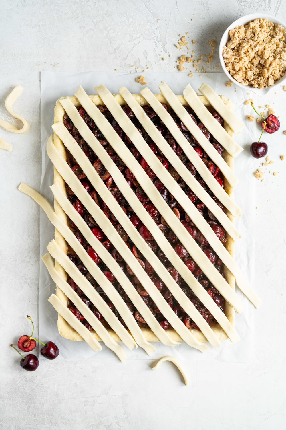 Cherry Slab Pie with Brown Butter Oat Streusel - a thick cherry slab pie is topped with a layer of flaky pastry and finished with a brown butter oat streusel that gives the most perfect crunch. #slabpie #streusel #cherrypie #cherryslabpie