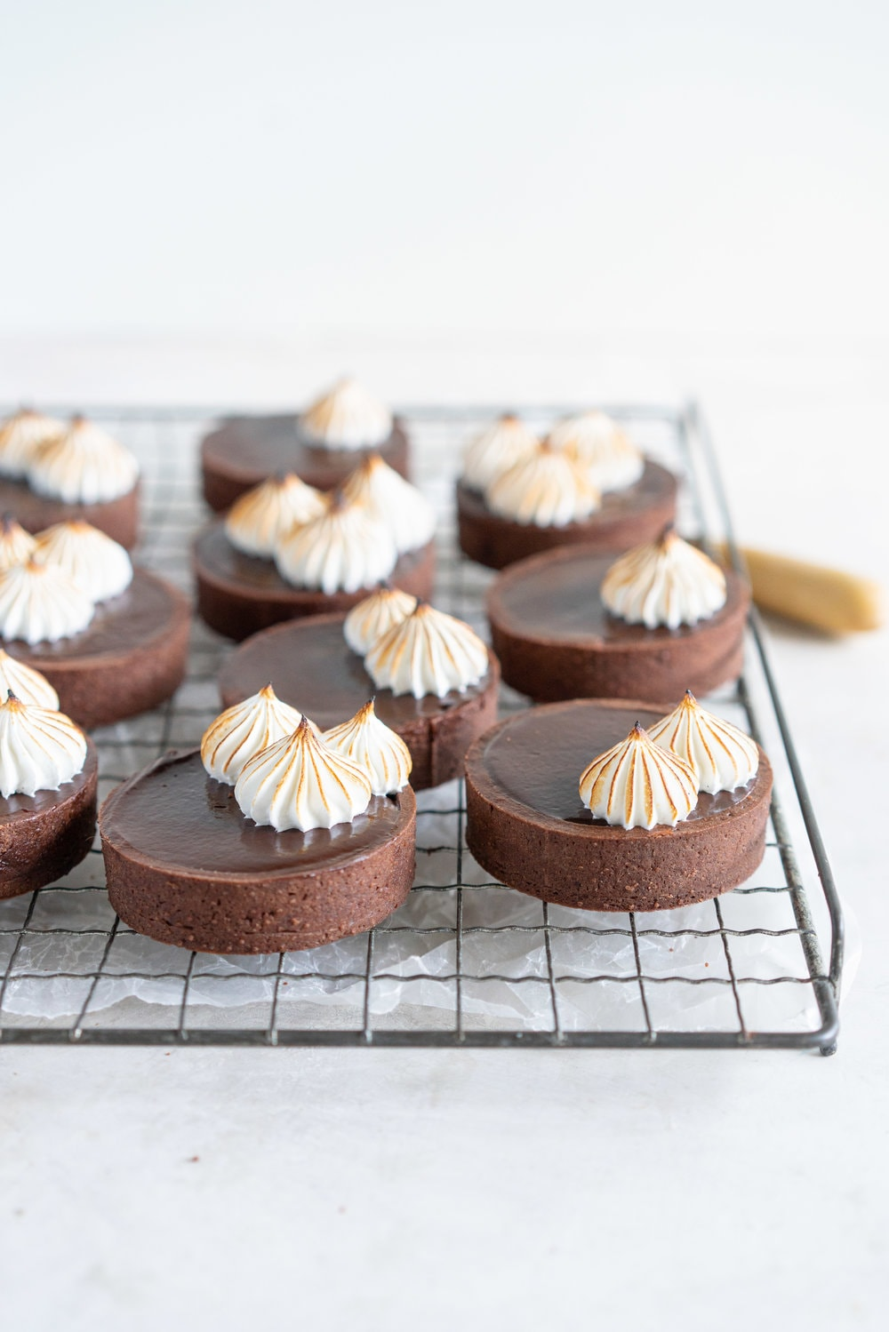 Dark Chocolate Peanut Butter Mini Tarts with Mixed Berry Jam, Chocolate Crust, and Torched Swiss Meringue #minitart #peanutbutterganache #chocolatetart