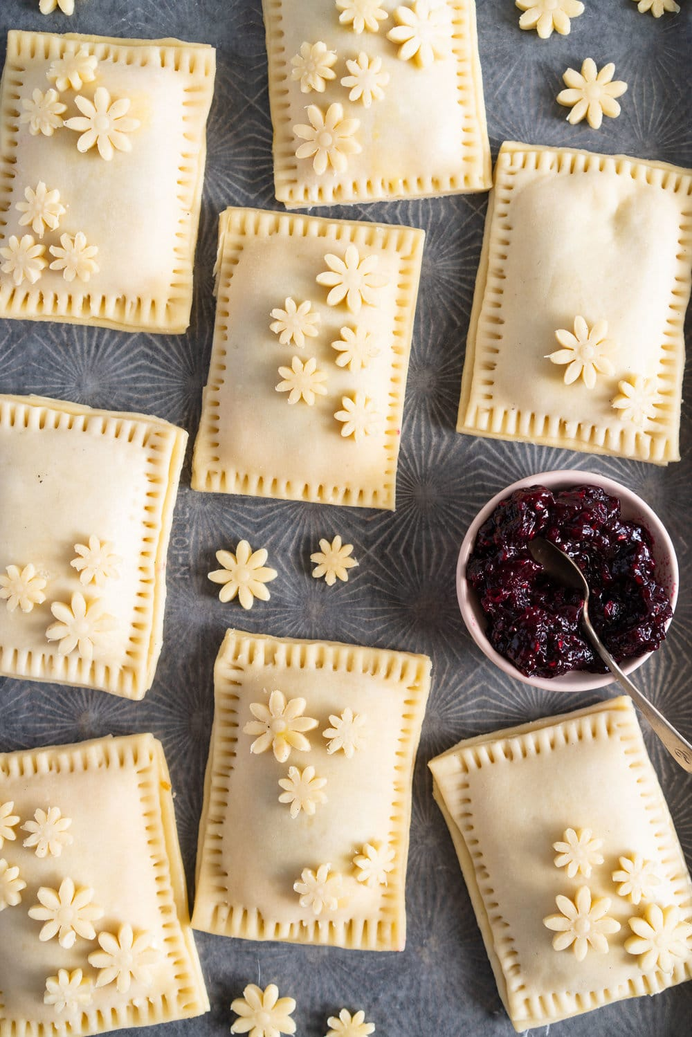 Mixed Berry and Cream Cheese Hand Pies - an easy flaky pie dough encases a mixed berry and vanilla bean cream cheese filling. These miniature pies are perfect for using up surplus cream cheese or jam that you may have, or for making use of slightly sad or tired berries. #handpies #easyhandpies #mixedberryjam