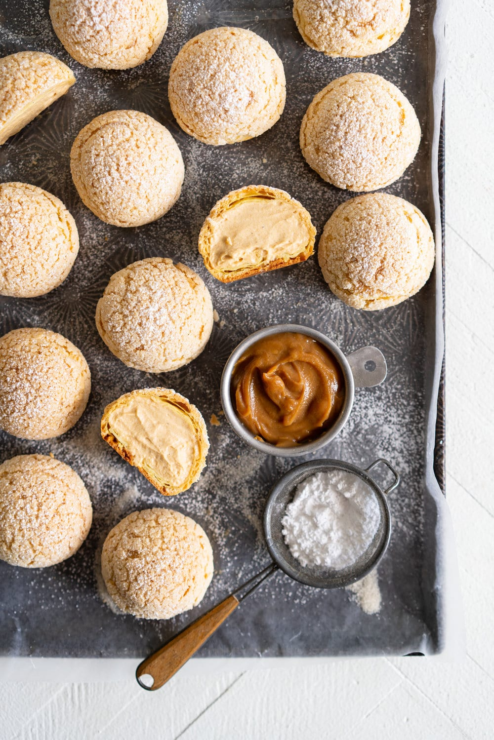 Golden Sugar Choux au Craquelin - Cream Puffs with Salted Caramel Diplomat Cream. These easy cream puffs, topped with crispy craquelin, are stuffed full with a salted caramel pastry cream, which is folded into softly whipped cream to form salted caramel diplomat cream. #creampuffs #chouxaucraquelin #saltedcaramel #diplomatcream