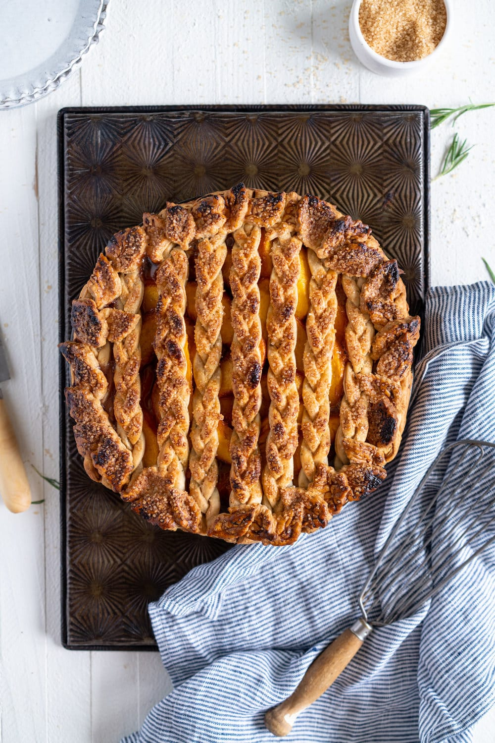 Peach and Vanilla Bean Pie with Fresh Rosemary Pie Crust - sweet, summer peaches are elevated with vanilla bean paste, and wrapped up in a sweet pie crust filled with fresh rosemary. #peachpie #peachandrosemarypie