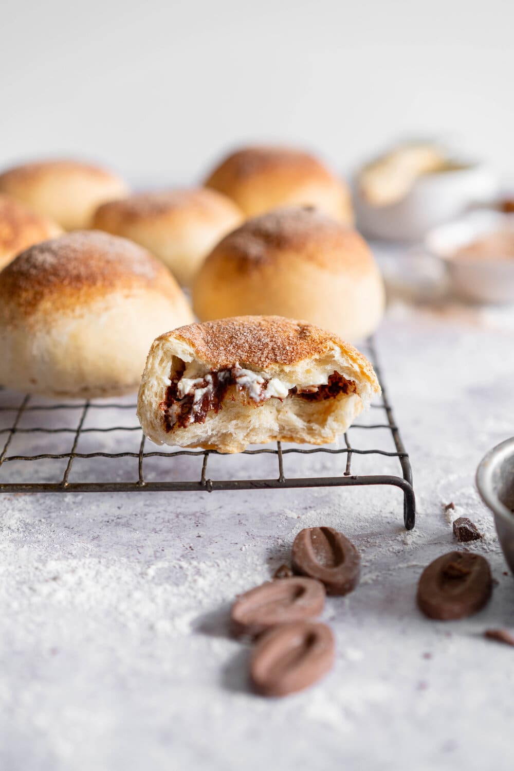 Cream Cheese and Milk Chocolate Stuffed Buns - sweet, soft white bread is filled with creamy milk chocolate and cream cheese, then brushed with butter and sprinkled with cinnamon sugar, then baked to golden chocolate perfection. #chocolatebuns #creamcheese