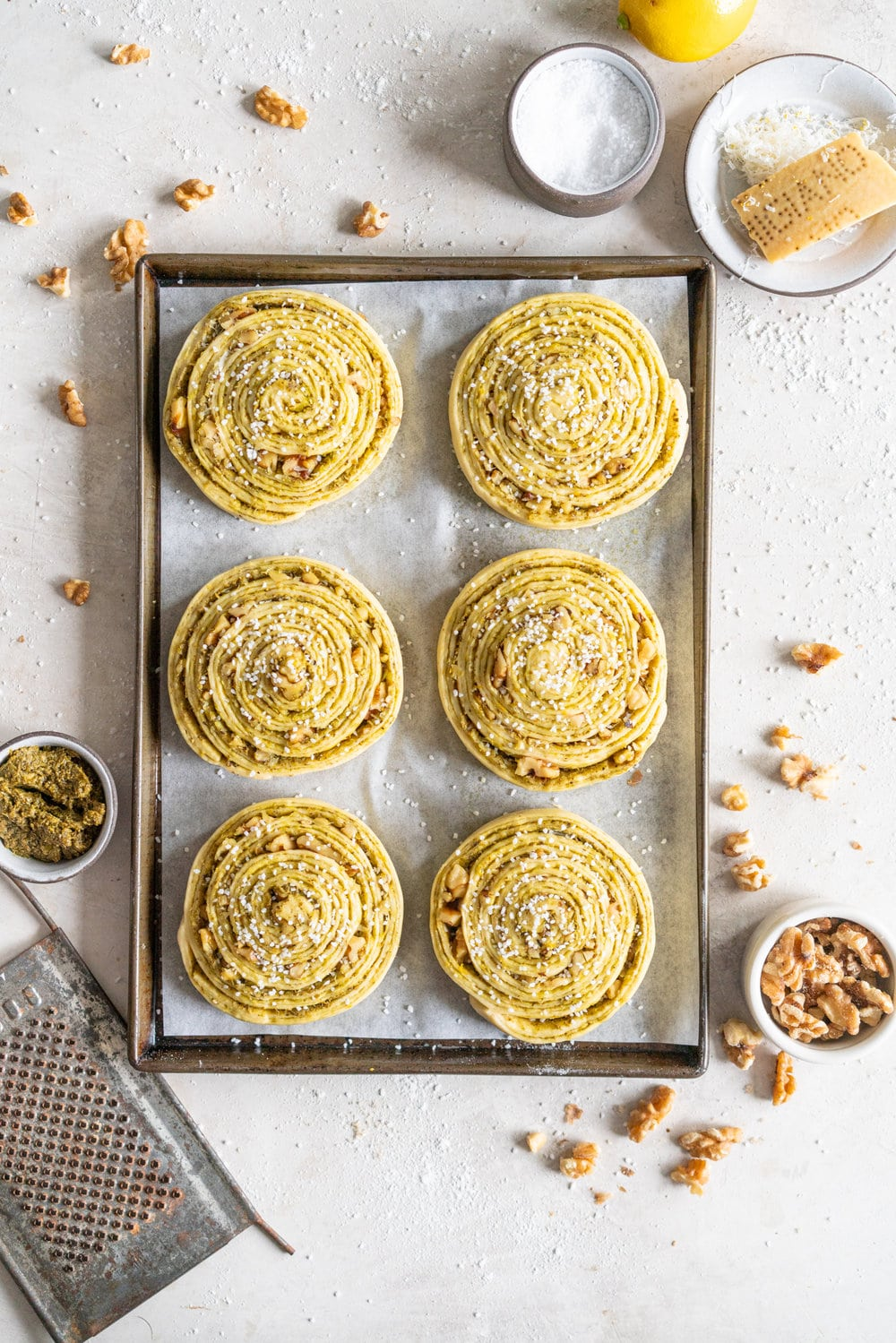 Laminated Brioche Pesto Buns with Lemon, Parmesan, and Walnut - buttery brioche is layered with zesty lemon, basil pesto and cheese, then sprinkled with walnuts and rolled up in to perfect pesto brioche pinwheel rolls. These are the perfect savoury take on a traditional laminated brioche #briocherolls #pestorolls #laminatedbrioche