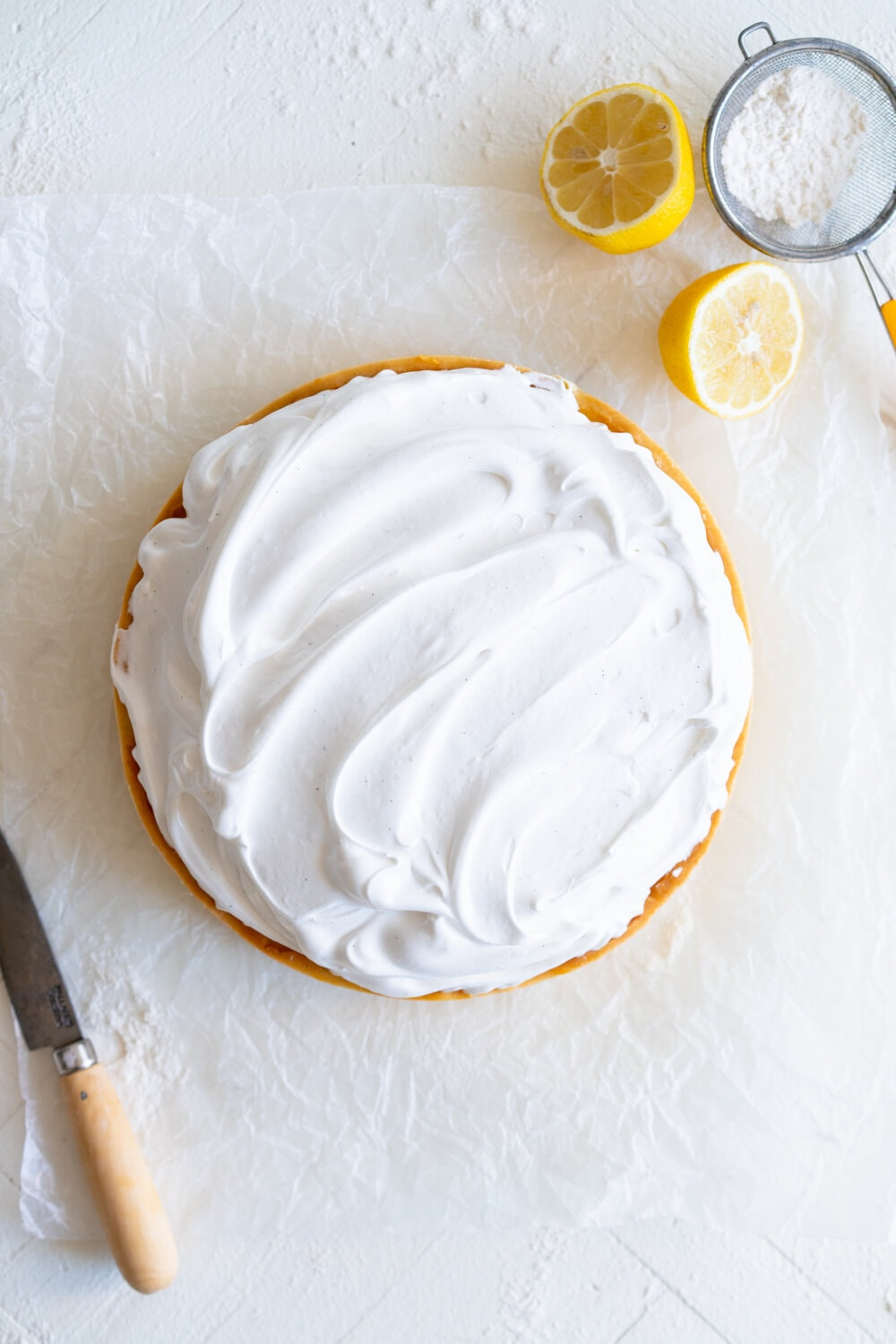 Lemon Meringue Tart with Torched Swiss Meringue. A sweet pastry case is filled with a punchy lemon filling and baked until it is silky and smooth in the oven. The tart is then finished in the oven, and Swiss Meringue is swooped onto the top and torched to perfection. #lemonmeringuetart #lemontart #swissmeringue