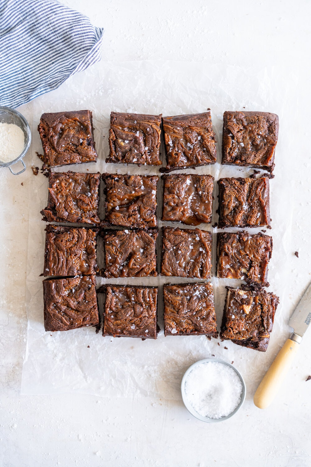 Peanut Butter Caramel Cream Cheese Swirl Brownies - fudgy brownies are swirled with a cheesecake cream cheese layer and then topped with a peanut butter caramel before being baked until fudgy and perfect. These are a must for any cheesecake or peanut butter lovers. #peanutbutterbrownies #creamcheesebrownies #cheesecakebrownies