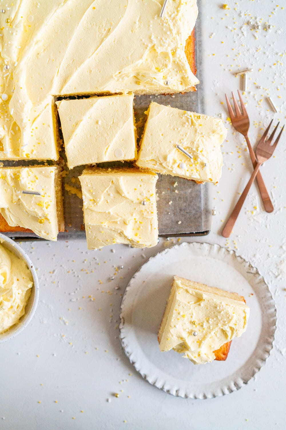 Lemon Yogurt Sheet Cake with Lemon Curd Swiss Meringue Buttercream. Fluffy lemon yogurt cake is topped with a punchy, silky lemon curd swiss meringue buttercream. This sheet cake is perfect for feeding a crowd. #sheetcake #lemoncurd #swissmeringuebuttercream