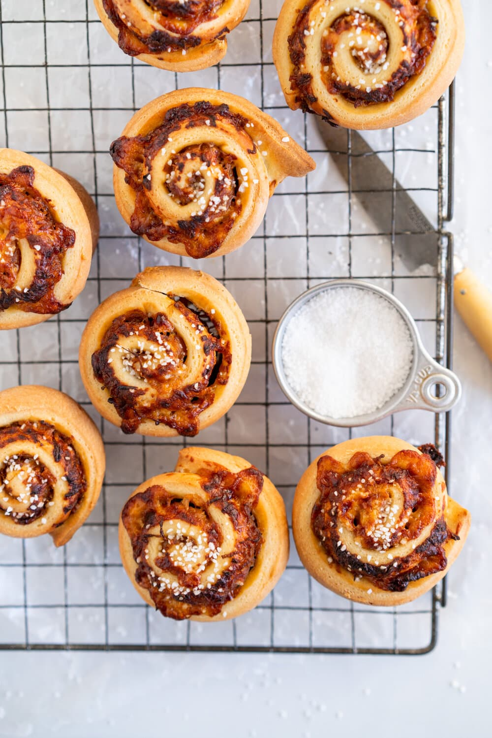 Sharp Cheddar cheese and caramelised onion brioche rolls. Fluffy brioche is spread with sweet caramelised onions and sprinkled with grated sharp cheddar, then rolled into perfect rolls and baked to perfection - cheesy onion goodness. These are easy to make and make the perfect savoury breakfast or brunch treat.