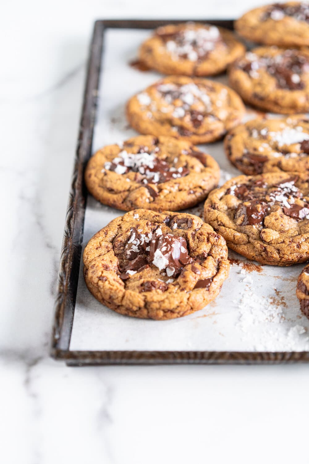 Brown Butter Spelt Chocolate Chip Cookies - these are a variation on the classic chocolate chip cookie. Brown butter provides depth of flavour along with spelt flour. The cookies are easy to make with a short chill time and are the perfect way to start baking using alternative grains such as spelt flour.