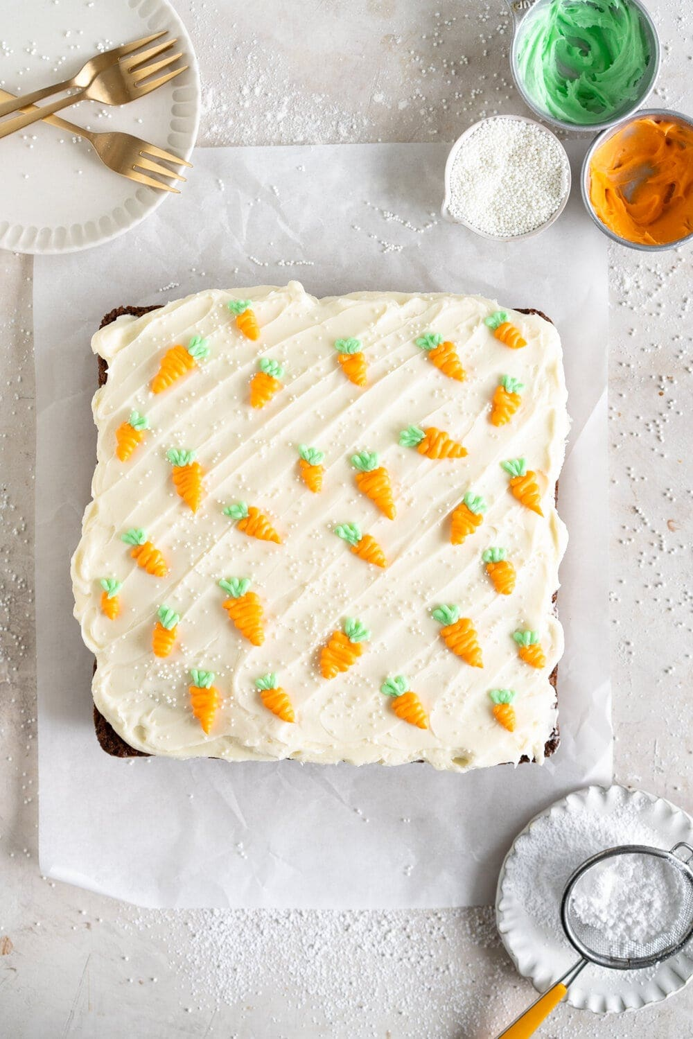 Carrot Snack Cake with Cream Cheese Frosting. This easy, moist, carrot sheet cake is the most perfect easter cake. It is made with pantry staples and finished with a simple cream cheese frosting and some super cute piped frosting carrots. This cake is great for a simple easter dessert, or for entertaining, as sheet cakes are super easy to transport.