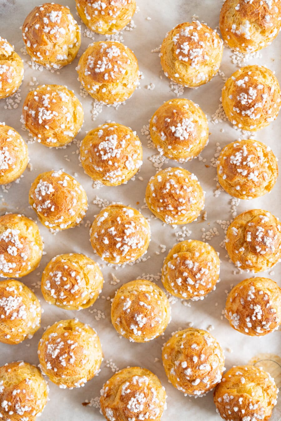 Brown Butter Chouquettes. Chouquettes are little choux pastry bites, piped into rounds and finished with pearl sugar before being baked to golden perfection. Choux is easy to make and is easy to freeze, making these the perfect treat. Brown butter choux has a delicious depth of flavour and is a perfect easy twist on a classic.