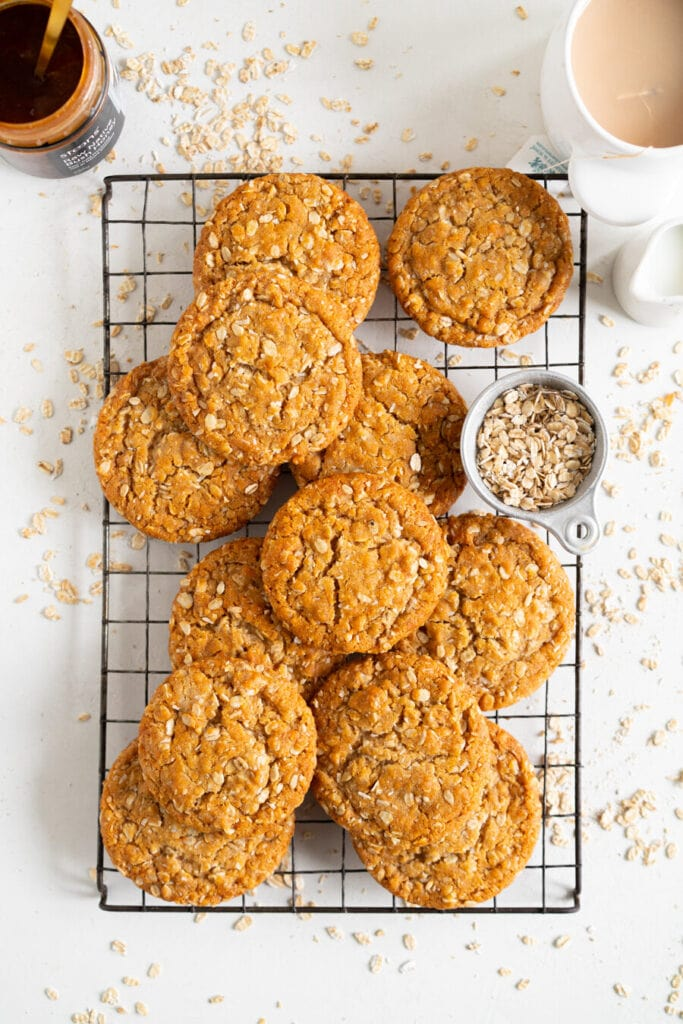 anzac biscuits on rack with oats and tea