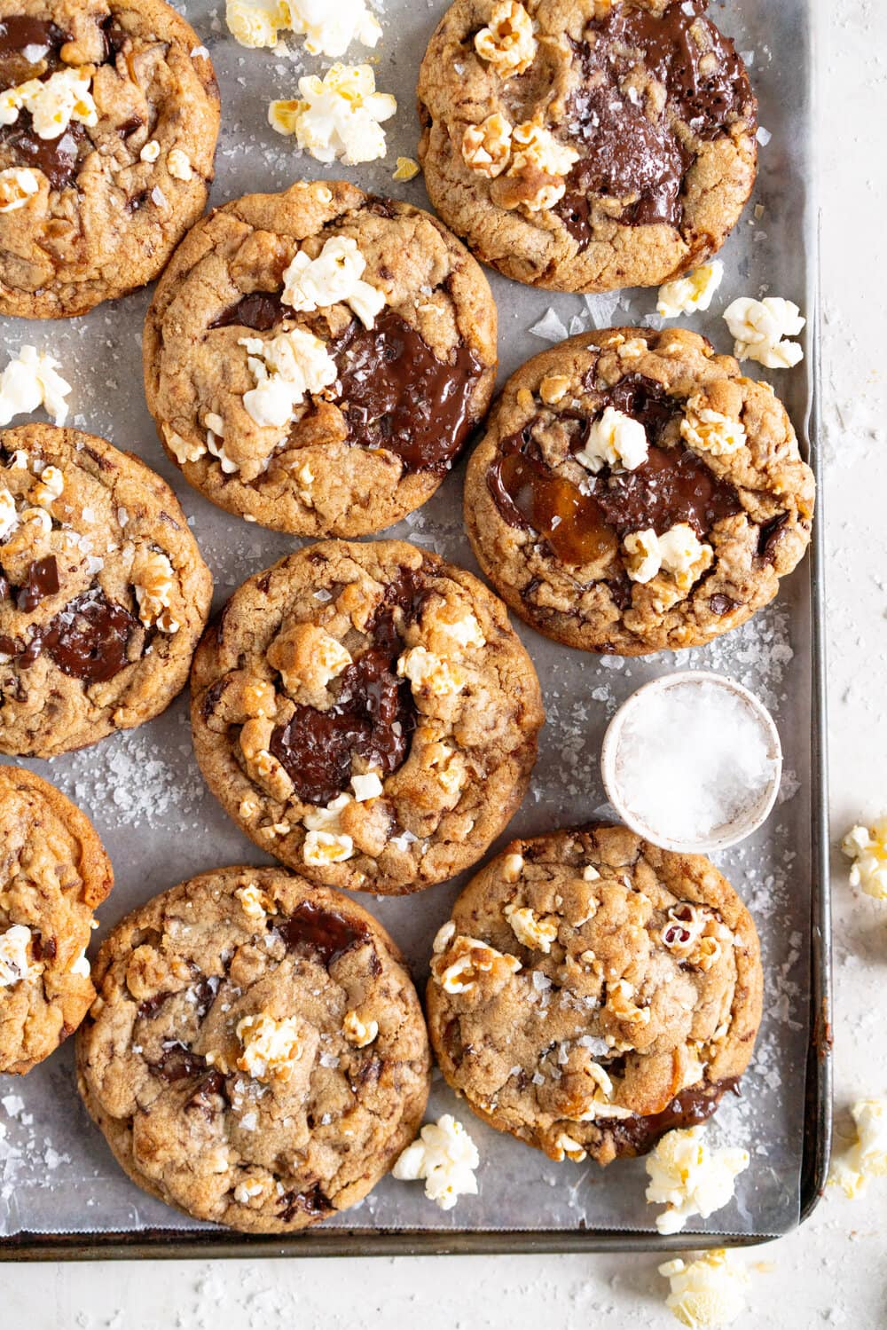 Brown Butter Salted Caramel Popcorn Chocolate Chip Cookies. Sweet, Salty chocolate chip cookies are filled with salted caramel chunks and freshly popped popcorn, then baked until perfectly round and crunchy. These are super simple to make and have the most beautiful chocolate puddles on top.