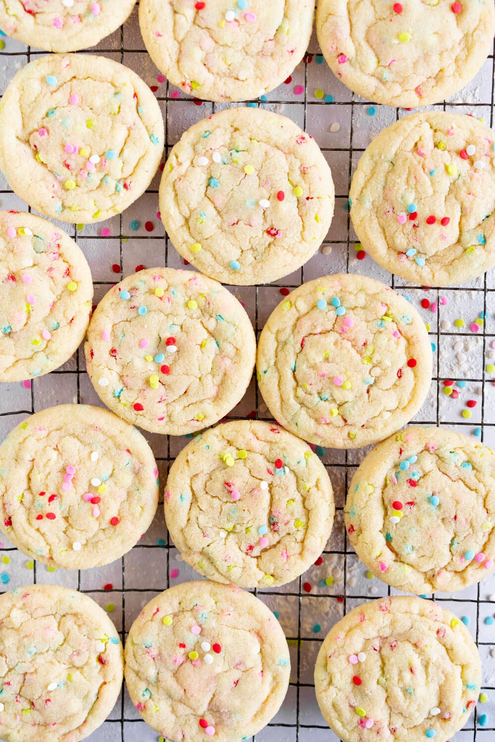 Vanilla Bean Sprinkle Sugar Cookies, AKA funfetti sugar cookies! These vanilla sugar cookies are soft and chewy, and bake up puffy, and are very easy to make with a delicious vanilla bean flavour. They are filled with rainbow sprinkles for a fun and easy take on the classic sugar cookie. They require no resting time, so bake up quickly and keep well.
