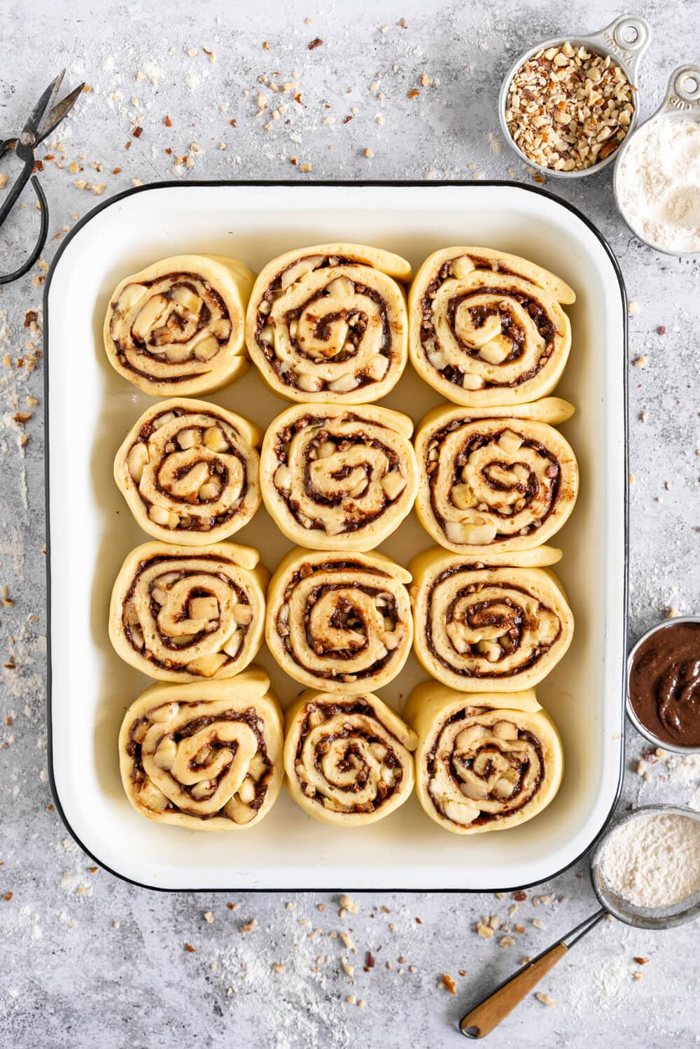 <yoastmark class='yoast-text-mark'>Nutella</yoastmark>, <yoastmark class='yoast-text-mark'>Banana</yoastmark> and Hazelnut Sweet <yoastmark class='yoast-text-mark'>Rolls</yoastmark> with Chocolate Cream Cheese Frosting. Soft, fluffy brioche is covered in <yoastmark class='yoast-text-mark'>nutella</yoastmark> and <yoastmark class='yoast-text-mark'>bananas</yoastmark>, and sprinkled with hazelnuts, then rolled up into perfect sweet <yoastmark class='yoast-text-mark'>rolls</yoastmark> and finished with a creamy and smooth chocolate cream cheese frosting. These are a great way to use up any extra bananas that you have around!