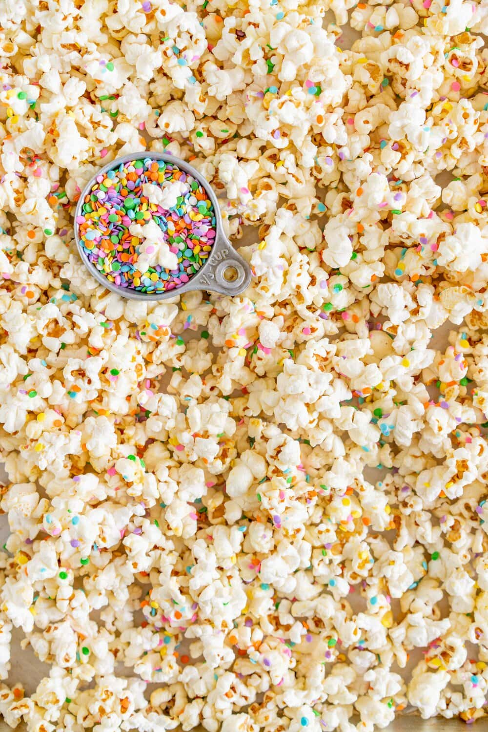 Funfetti Kettle Corn (Sprinkle Kettle Corn) - this sweet, salty snack is the perfect fun treat. Kettle corn is made on the stovetop, and crunchy confetti sprinkles are added for a funfetti twist. This Kettle corn recipe is easy, and is great for making with kids.